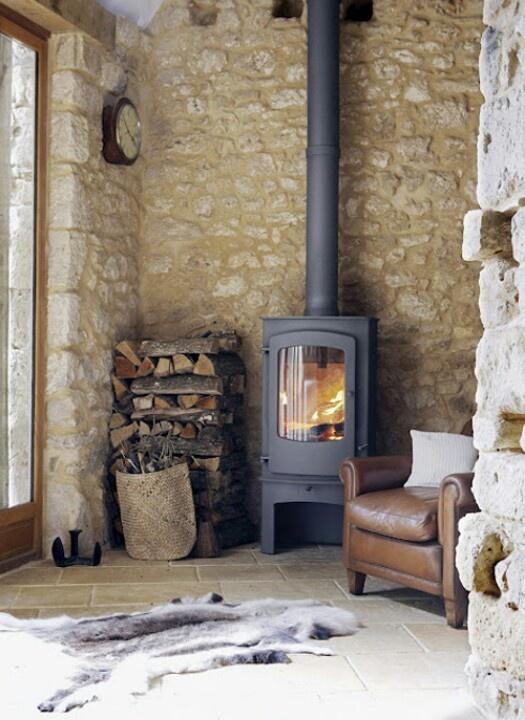 Limestone wall behind wood burning heater.