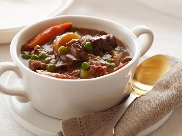 Get Parker's Beef Stew Recipe from Food Network  Christine says: There's no need to brown the beef first, but do toss it with 1/4 cup flour (not the full amount called for in the recipe), salt, and pepper first before placing it in the slow cooker with the other ingredients. Cook on the HIGH setting until the beef is tender (stir once or twice if you can), about 5 hours. Add the peas and cook 5 minutes until heated through.