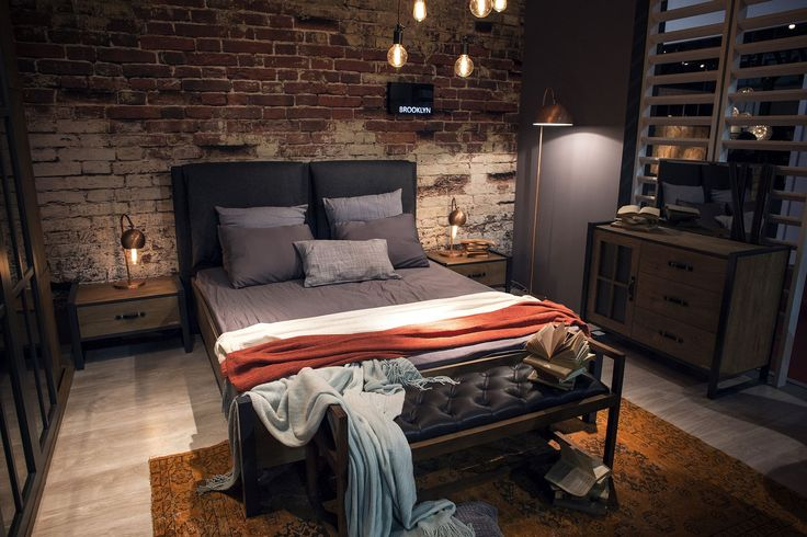 Metallic floor and table lamps are perfect for the industrial bedroom