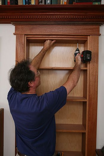 How to install a hidden pivot bookcase. And here I thought only millionaires could have these ...