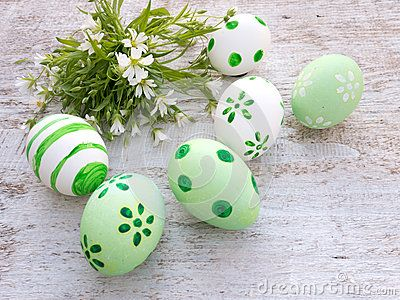 White and green easter eggs and wild flowers bouquet