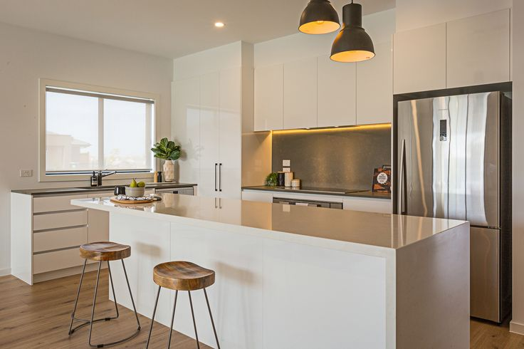 Clean, sleek and white - what more could you ask for in a kitchen!