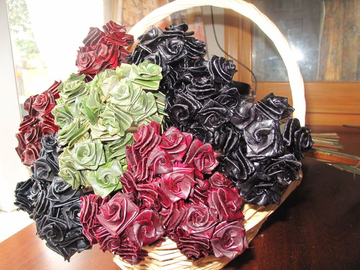 A basket full of different coloured flax woven roses - creation of Forever Flax