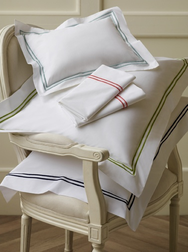 SFERRA's Grande Hotel bed linens in new colors Aqua, Salmon, Chartreuse, and Navy.