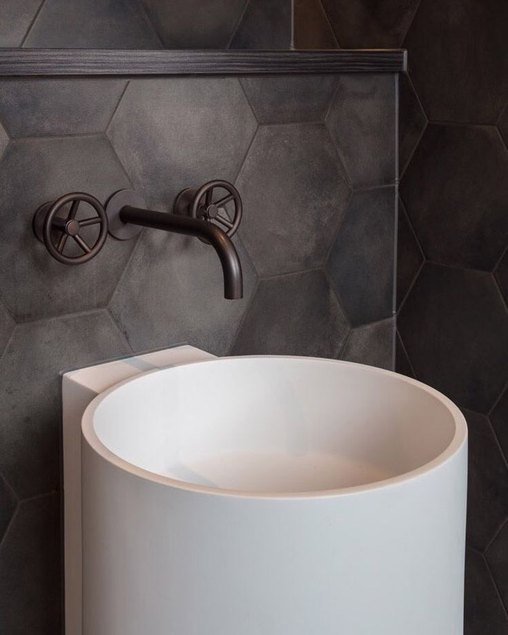 Shades of warm grey. Our Brooklyn basin tap in Charcoal. Interior design & Architecture by Gpad, London