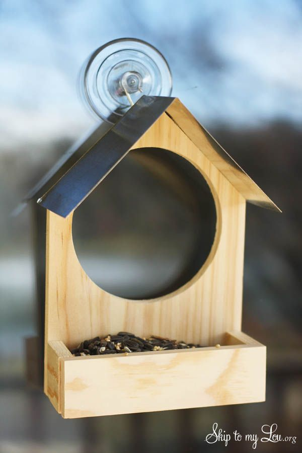 DIY wooden bird feeder with watching hole. Stick this right to your window and watch the birds come right up to your house #diy #birdfeeder