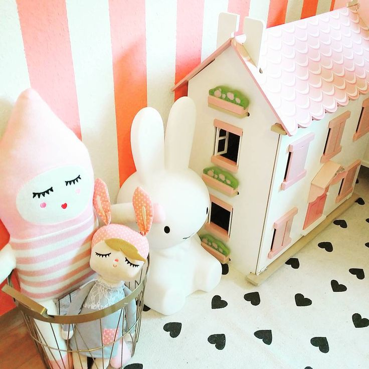 Pink and white striped walls, Le Toy Van dollhouse, Lucky Boy Sunday doll, Miffy Lamp. www.amotherslove.de