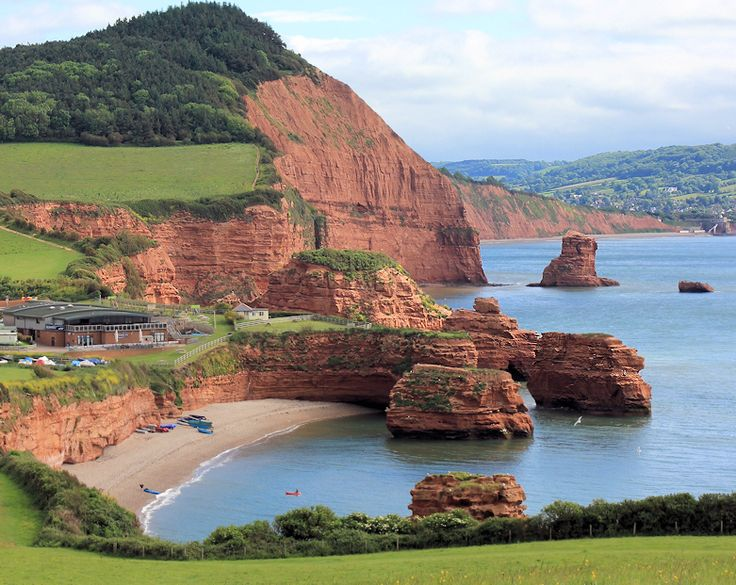 Ladram Bay, Devon, with High Peak and Big Picket Rock beyond and Sidmouth in the distance.