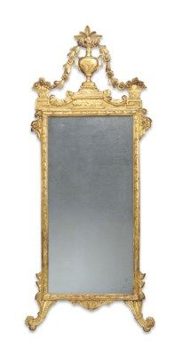 ITALIAN GILTWOOD MIRROR  LATE 18TH CENTURY  THE VASE CRESTING WITH TRAILING GARLANDS, WITH PARTIAL BLACK INK NUMBER 16....1, LATER MIRROR PLATE 81 IN. (206 CM.) HIGH, 39 IN. (89 CM.) WIDE