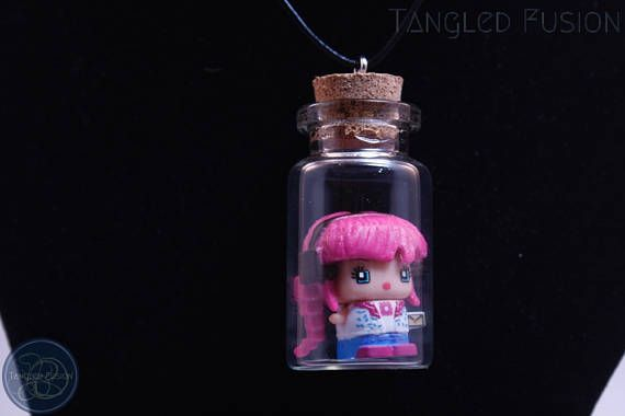 Quirky Glass Vial Necklace with MixieQ Figurine on Leather https://www.etsy.com/au/listing/533294887/quirky-glass-vial-necklace-with-mixieq?ref=shop_home_active_7