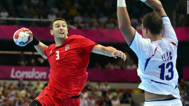 8/6/12 - Hungarian back Ferenc Llyes, let, takes a shot in front of Serbia's Momir Ilic during the men's preliminary Group B handball match.  Awesome sport... saw this sport in Atlanta in 1996.