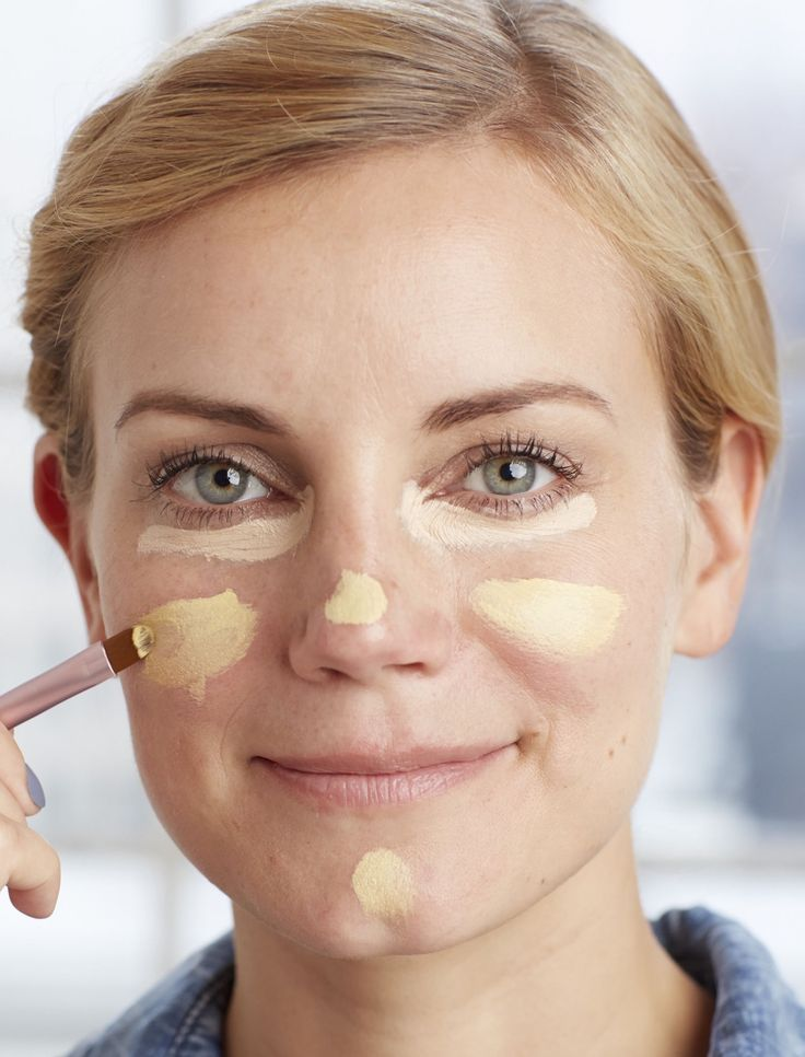 To neutralize redness on your cheeks, nose, and chin, swipe on a yellow-based cream concealer, as shown above. For under your eyes, apply one that's two shades lighter than your skin.
