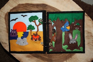 This quiet book is made up of great nature scenes with little finger puppets in pockets. I love the detailed stitching. From The Quiet Book Blog: Shelley's Quiet Book