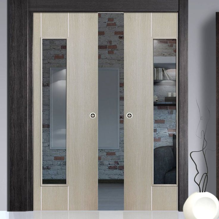 Double Pocket Nuance Viridis sliding door system in three size widths with Clear Glass. #modernpocketdoors #interanlmodernpocketdoors #glazedpocketdoors
