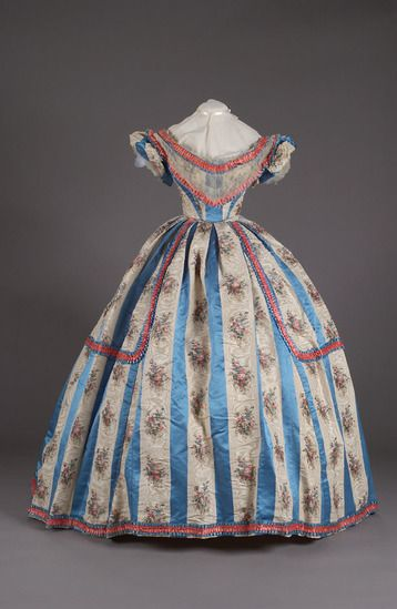 Blue satin and white floral moiré striped ball gown with ruched pink and blue satin trim, ca. 1860.