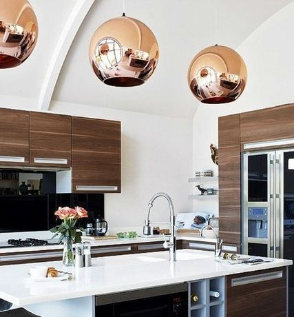 copper pendants over kitchen island / contemporary wood cabinets