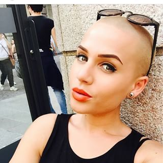 And this woman, whose buzz cut offsets her fierce attitude. | 21 Gorgeous Women Whose Shaved Heads Will Give You Life
