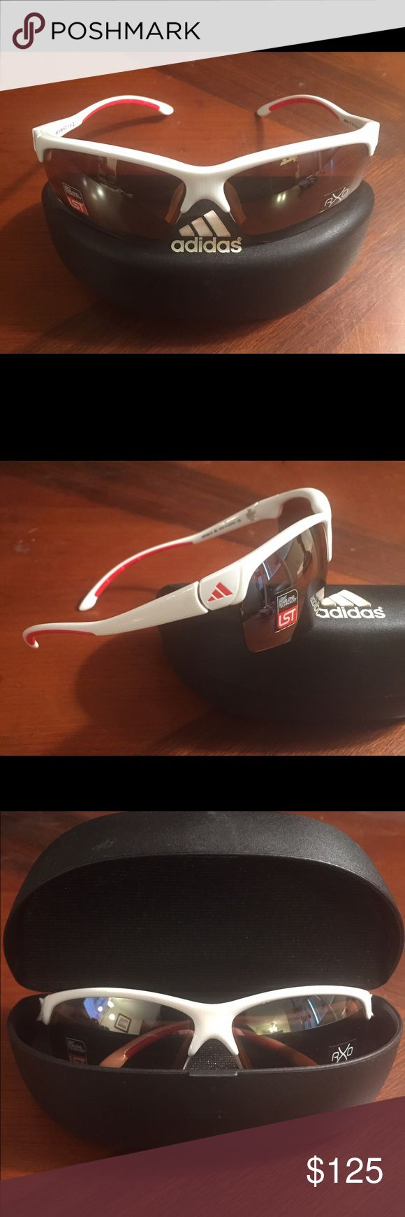 Adidas Adivista Sunglass Oh so lightweight!! These cool unisex white and red sport wrap sunglasses have great coverage. Has adjustable nose pads and comes with inserts for prescription lenses if needed. The lenses are a patented Light Stabilizing Technology (LST). Great drivers lens or for those who golf. Anybody really. Adidas Accessories Glasses
