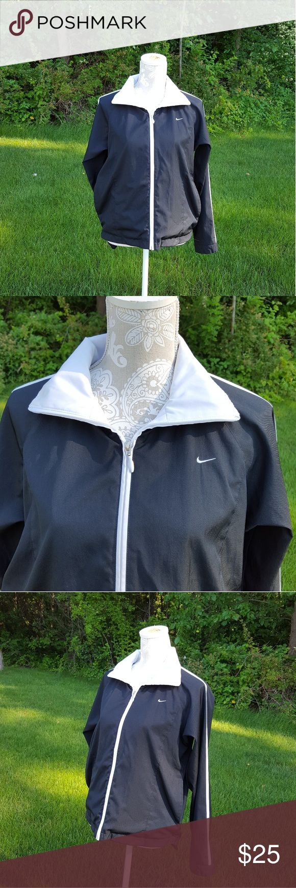 Nike Black and white zip up track jacket Has been worn Size medium Zip up Wind breaker material  Long sleeves Collared  No Trades Nike Jackets & Coats