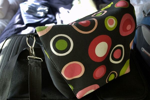 DSLR camera bag and purse in one - a cute way to travel with your big camera.