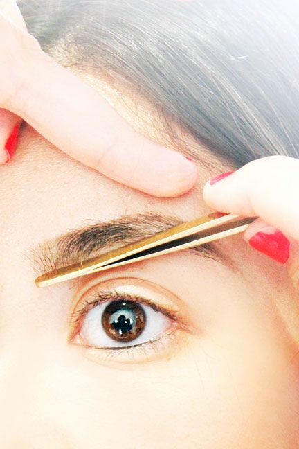 "See Open Spaces... ""The bottom portion of the brow is the most crucial area to fill,"" says Vucetaj, who held her tweezers against the front of the brow and inner arch ""to see what was missing.""  Read more: How to Trim Eyebrows - Eyebrow Shaping Tips - ELLE"
