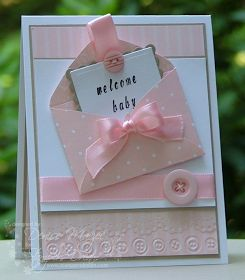 What a sweet baby card!  Multiple layers, soft colors and shiny ribbons make this a very professional-looking handmade baby card.  Wait until you see the inside!