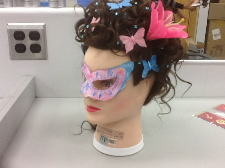 17th century hair style with the mask.