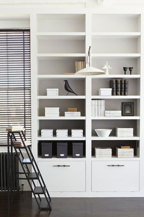 Love this bookcase for its simplicity and the the doors at bottom which are flush with the rest of the shelf. Makes me realise we should do handles if we can find some really classy ones. tonal ombre shades of grey in background is nice but not something we'll do.