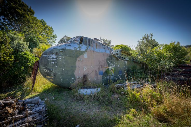 A salvage Bristol 170 freighter airplane found abandoned and overgrown in rural New Zealand. Purchase a print, cards, mugs, a phone case or a full size digital file of this image at www.kirkvogel.com