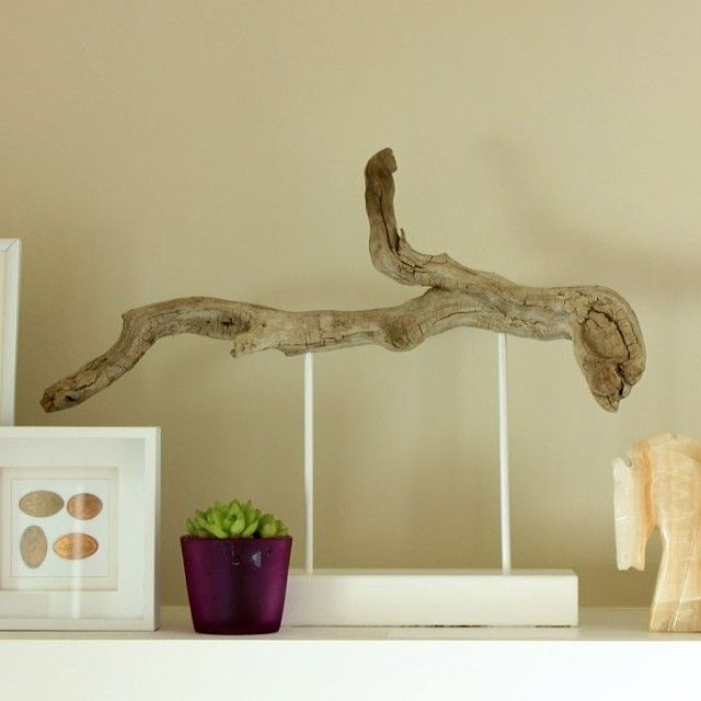 Attach driftwood to pedestal - drill holes in scrap piece of wood for dowels, drill similar holes in the driftwood