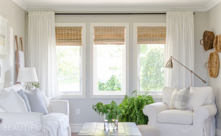 Woven wood shades add color, texture and warmth to this modern farmhouse living room.