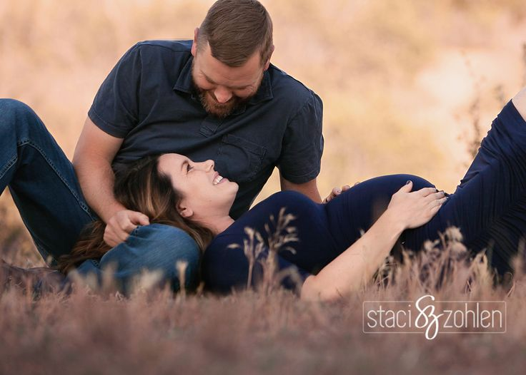 maternity in a field.. mom laying down