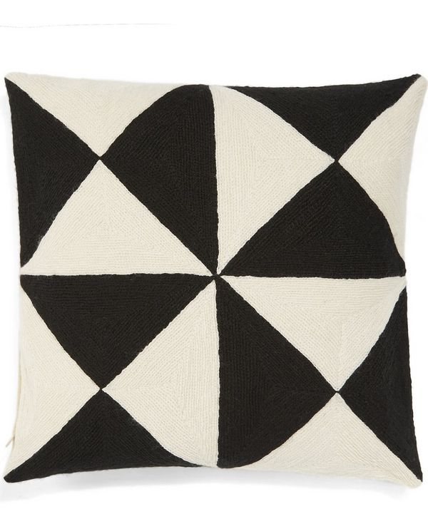 Give living space a punch of bold geometry with this meticulously hand embroidered chain stitch Lindell and Co cushion.
