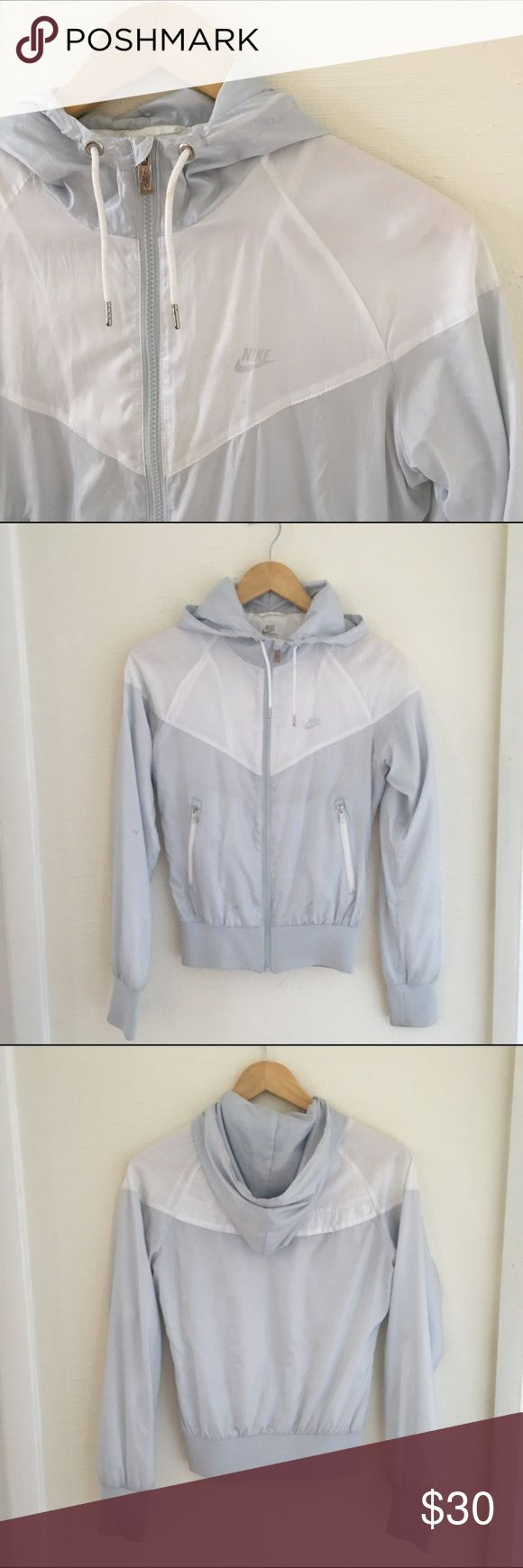 Nike Windbreaker Raincoat Running Jacket Super chic running jacket with mesh interior and windbreaker exterior. Very lightweight. Hooded, zip up, snug fit.  A flattering ice blue color. Nike Jackets & Coats