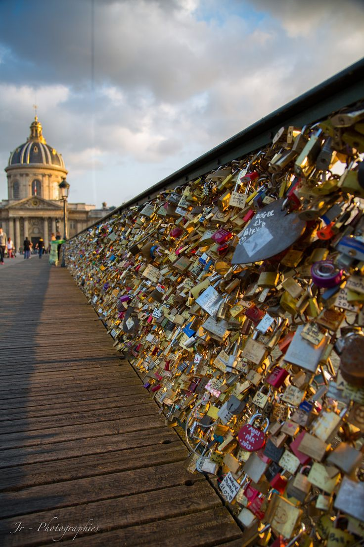 Pont des Arts Love Locks pedestrian bridge in Paris, walking distance from the Louvre. Write you and your loves name on the lock and throw the key in the river. Would love to do this some day when I go to Paris!
