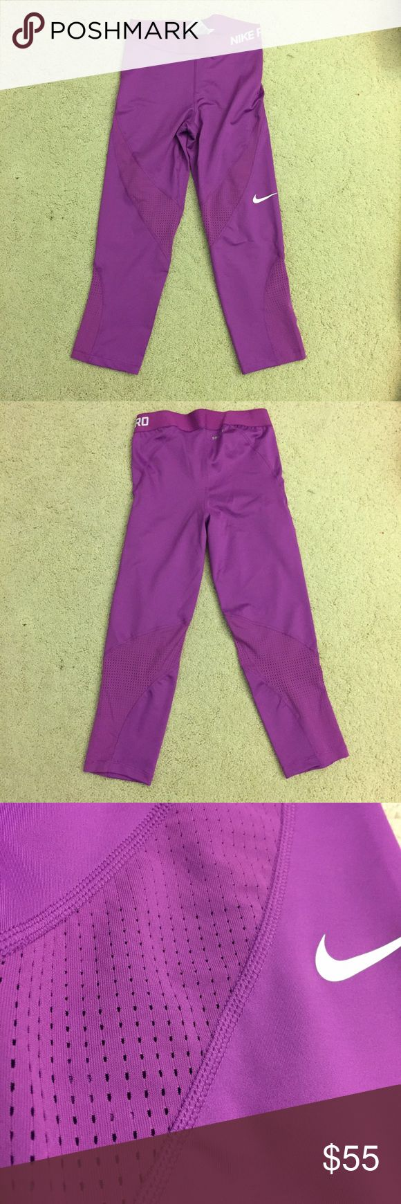 NWOT Nike Pro Hypercool Cropped Super cute bright purple cropped leggings! It has mesh detailing. Worn once. Perfect condition. Nike Pants Leggings