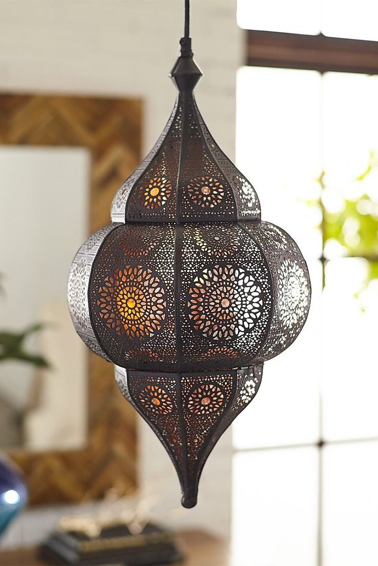 The mystique of a Moroccan lantern is evident at the first glow of Pier 1's Ayla Bronze Pendant Light. Here, we recreated the look with intricate iron tool work and a bronze-toned finish, so our plug-in pendant casts its lace-like pattern of diffused light without the worry of a candle.