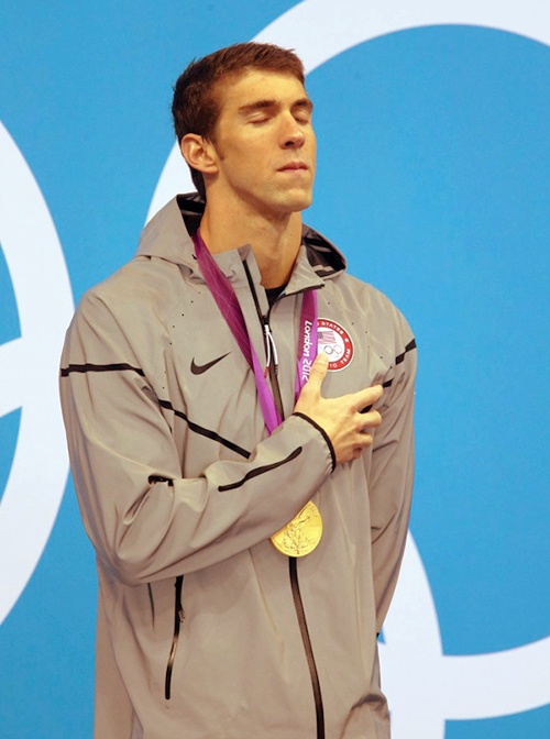 The supposed last time Michael Phelps will stand atop an Olympic podium and hear his national anthem...