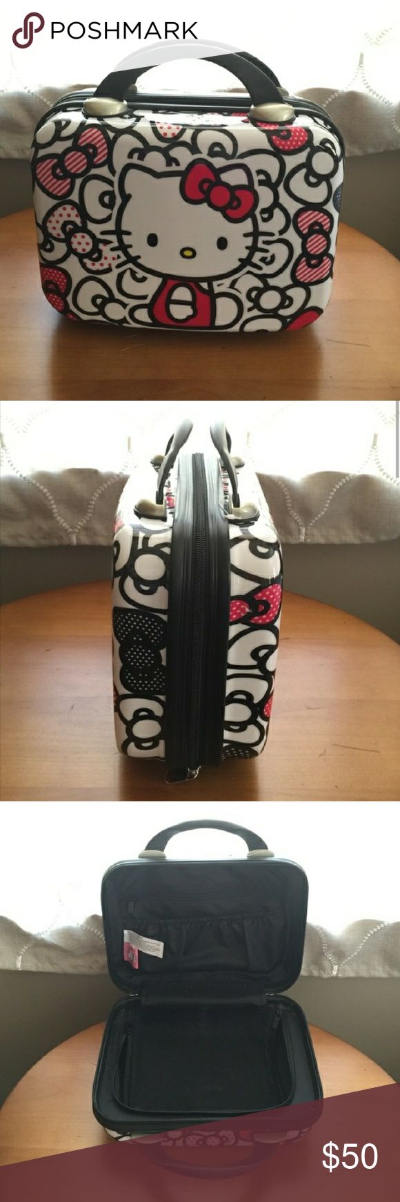 Hello Kitty hard travel make-up case Great way to travel and not worry about breaking your expensive make up.  In great condition.  Has mesh zip nets inside to hold your items in place. Hello Kitty Bags Cosmetic Bags & Cases