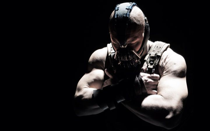 The World Of Batman: Tom Hardy as Bane has the same physicality and unbreakable will as Batman, but a childhood spent in a hellish prison molded him into a hardened killer. Thanks to his Venom super-steroid, he broke Batman's back and took over Gotham.