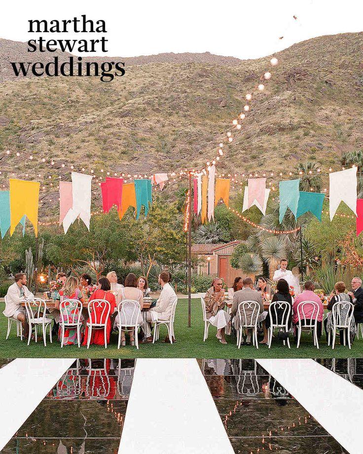 Exclusive: See Samira Wiley and Lauren Morelli's Incredible Wedding Photos | Martha Stewart Weddings - Felt flags waved above at dinner.