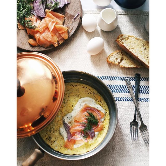 French Omelettes With Smoked Salmon And Dill Cream Sauce. Get this and 150+ more Breakfast Eggs recipes at https://feedfeed.info/breakfasteggs