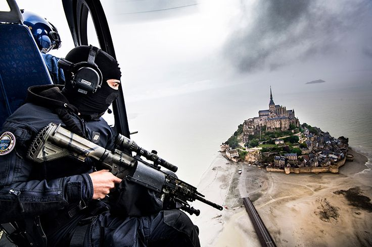 First prizein Europol photo competition: Fabrice Balsamo from France. Gendarmerie EC145 helicopter on a security mission during the start of the Tour de France from Mont St Michel. Category: Making Europe safer.