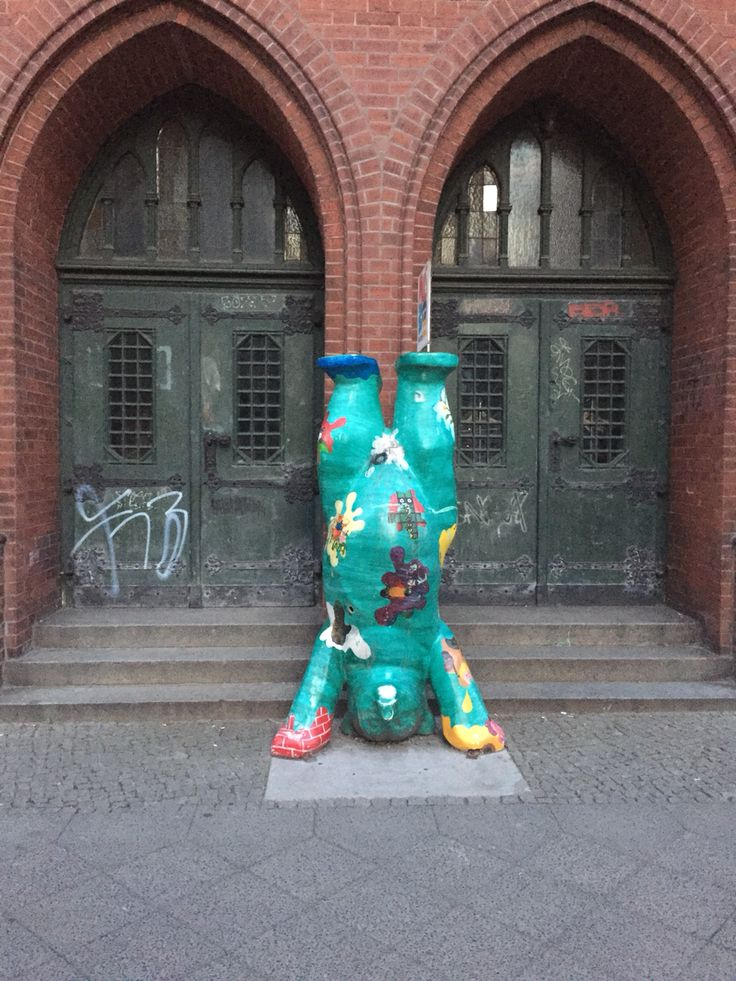 A multicoloured bear doing handstand push-ups on a random street in #Berlin #Germany Because normal is overrated!  #travel #berlin #germany