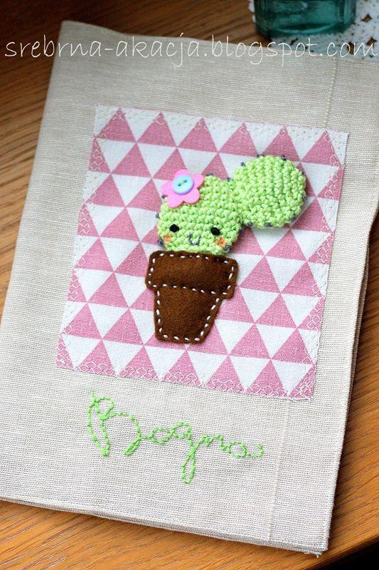 A little crochet cactus on a children's health book envelope