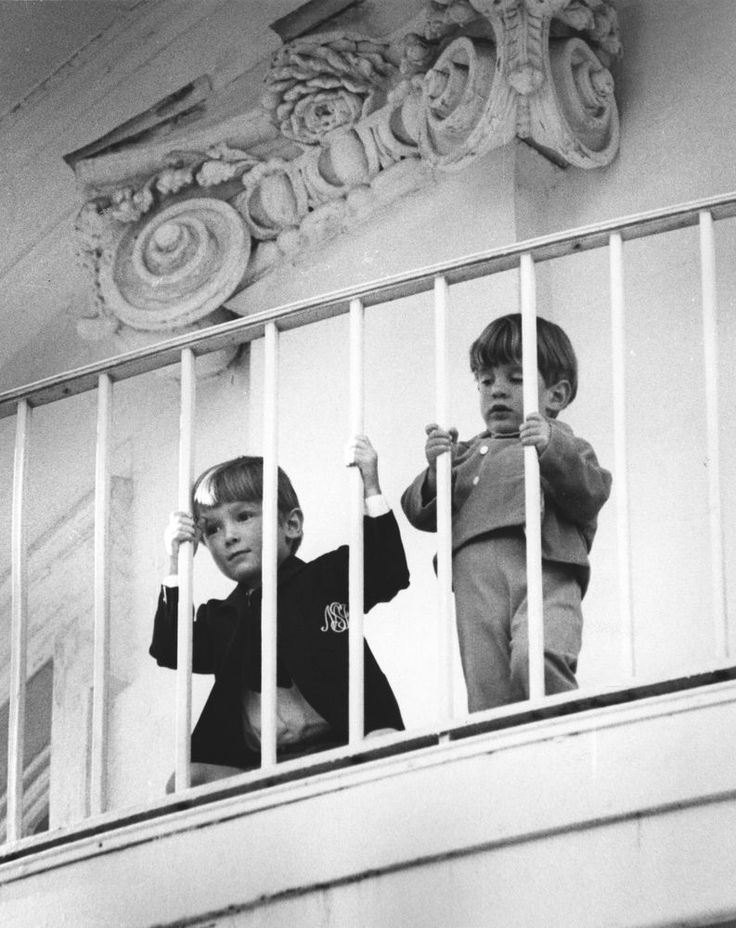 John Jr. watching his father give a speech from the White House balcony.