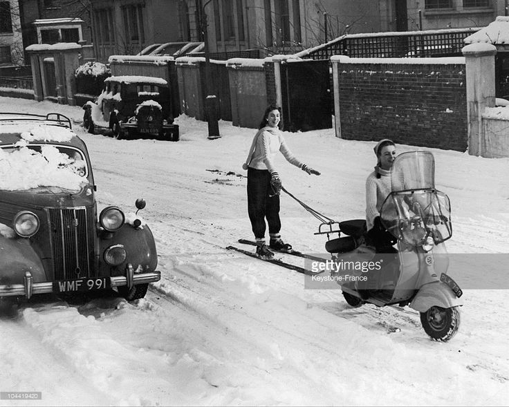 A Young Women From Kensington, Great Britain, Skiing While Pulled By Her Friend On A Moped On January 15, 1955.