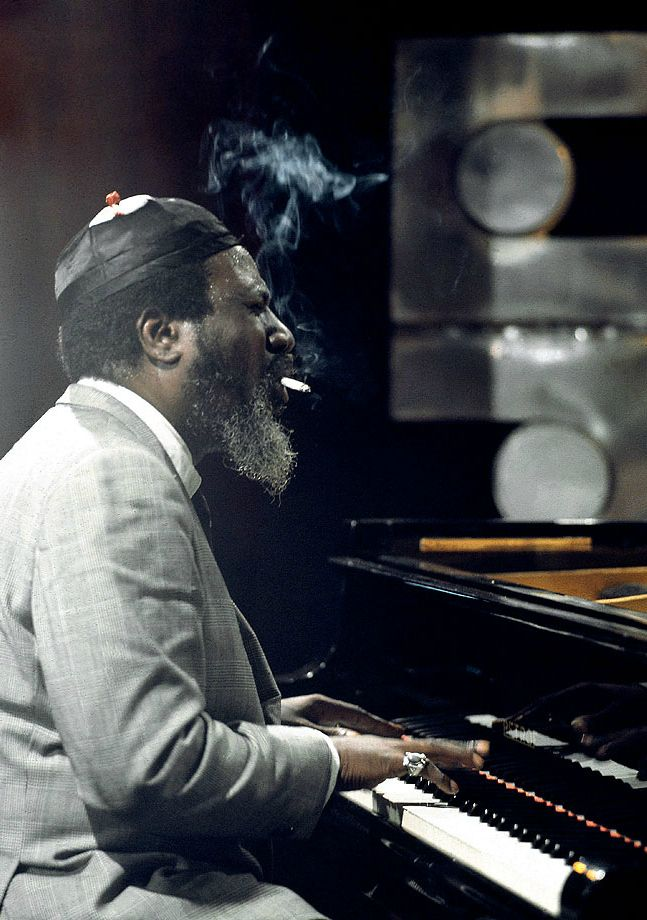 """Thelonious Monk was an American jazz pianist and composer, considered one of the giants of American music. Monk had a unique improvisational style and made numerous contributions to the standard jazz repertoire, including """"Epistrophy"""", """"'Round Midnight"""", """"Blue Monk"""", """"Straight, No Chaser"""" and """"Well, You Needn't"""". Monk is the second-most recorded jazz composer after Duke Ellington, which is particularly remarkable as Ellington composed over 1,000 songs while Monk wrote about 70."""