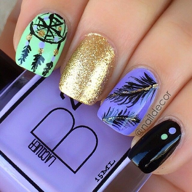 @Manal Maz Shaikh -Dreamcatcher with gold and black accent nails nailart