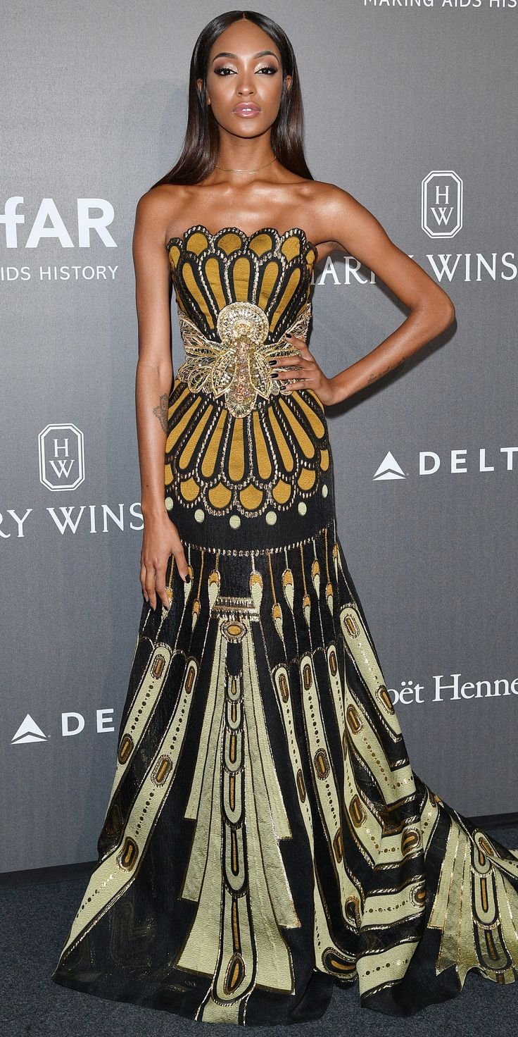 Look of the Day - JOURDAN DUNN from InStyle.com Jourdan Dunn absolutely radiated at the amfAR Gala Milano in Milan, Italy, wearing a beyond-gorgeous gown with intricate gold beading. The supermodel kept her accessories simple by going for just a simple and sleek gold choker necklace.